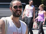 It pays to be flexible! Russell Brand chats up yet another woman after yoga class