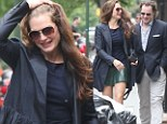 A little romance: Brooke Shields and husband Chris Henchy appeared to be in high spirits as they strolled through springtime New York, on Sunday