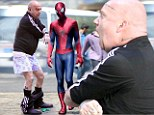 Unfair move! Costumed Andrew Garfield ripped down Paul Giamatti's pants on set of The Amazing Spider-Man 2 in Brooklyn, New York, on Monday