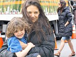 New play buddy! Katie Holmes was full of smiles as she held her young male co-star in her arms on set of Mania Days in New York City on Monday