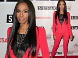 She's not hiding anymore! Michelle Williams heats up the 2013 SESAC Pop Music Awards in a bright pink suit and leather bra