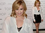 Leather and lace! Demi Lovato plays up her figure in a tight mini skirt and see-through camisole