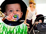 That's her boy! Elizabeth Banks shows off her new son Magnus on family trip to the beach