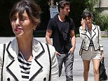 Kourtney Kardashian takes fashion tips from Britney Spears in a circus-inspired shorts suit for day out with Scott Disick