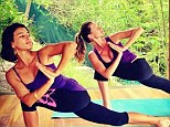 Way to start the day! Gisele Bundchen tweeted a snap of her morning yoga session with friend Cristina Kalyani Paes in a tropical wonderland, on Tuesday