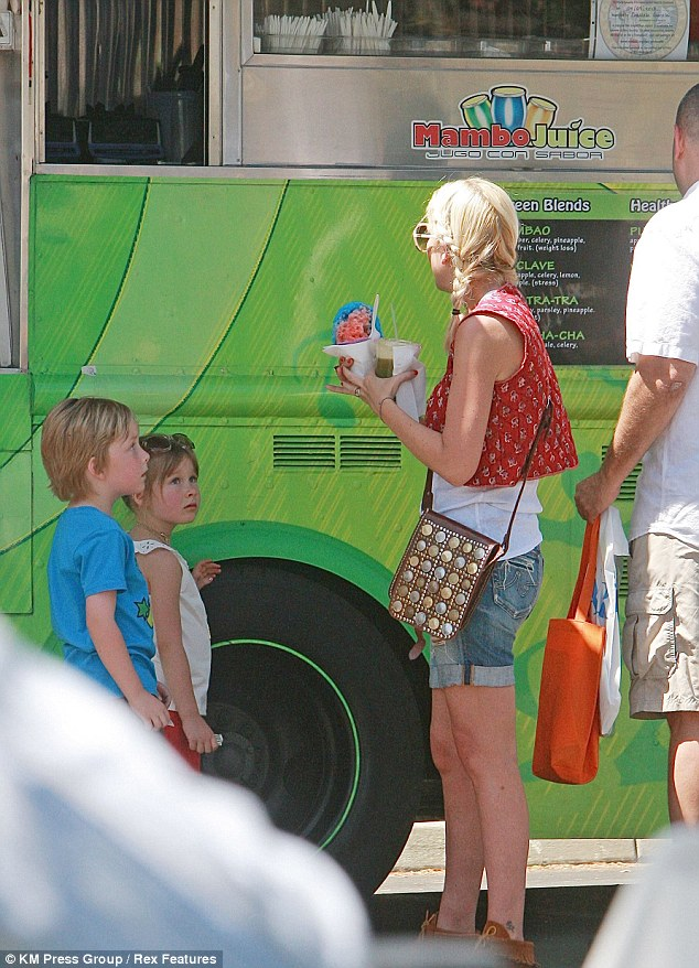 Treat time: Tori stopped by a food truck for refreshments with Liam and Stella