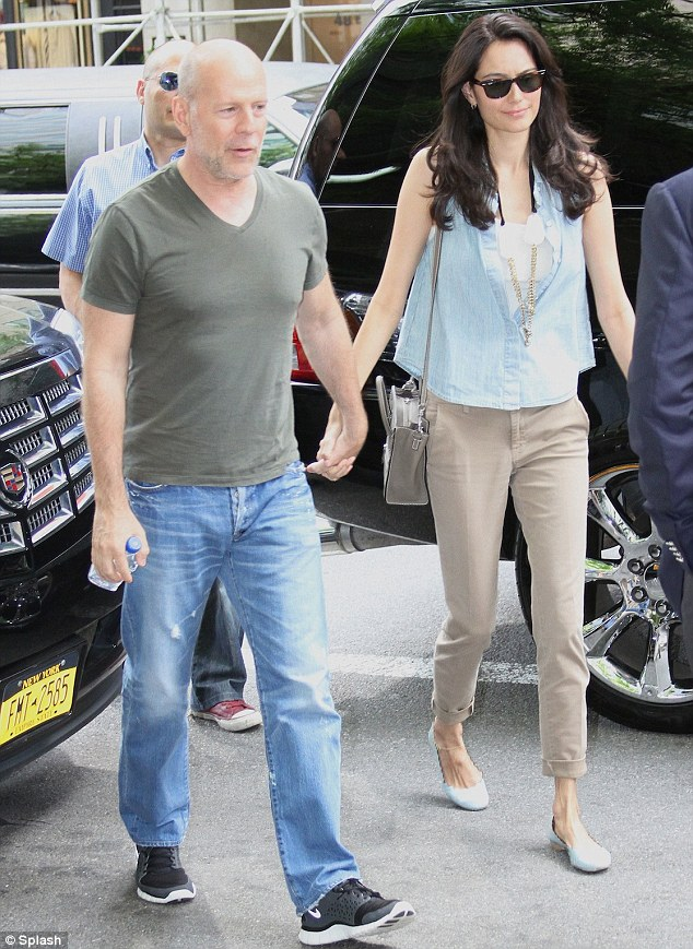 Dressed down: The couple appeared laid back for their afternoon outing, both sporting casual trousers and tops