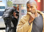 Here comes Mr Bump! Kanye West avoids walking into street signs in New York (but still has painful reminder of clonk)