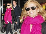 The drama is behind her at least! Reese Witherspoon beams as she arrives in New York with a stern-faced Jim Toth