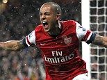 Pure ecstasy: Theo Walcott celebrates after scoring for the Gunners (below) with 63 minutes gone