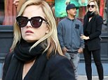 The best things come in (very) small packages! Mena Suvari goes for a stroll with her pint-sized boyfriend in New York