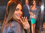 In the trenches? Sofia Vergara covers up her famous curves as she and the Modern Family cast gather in NYC