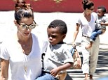 Sandra Bullock and little Louis both sport rolled-up trousers as she picks him up from school