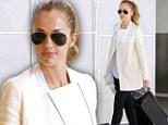 Cream of the crop! Minka Kelly arrives to Los Angeles in a gorgeous white coat that complements her new blonde locks