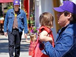 She weighs more than 21 Grams! Benicio Del Toro lifts daughter Delilah as they enjoy outing in Los Angeles