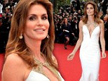 Dynamite in white: Cindy Crawford looked stunning on Wednesday on the red carpet for the screening of The Great Gatsby as part of the Cannes International Film Festival in France