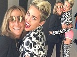 Where are your trousers? Miley Cyrus poses in just a pair of pink underpants teamed with skull thigh high boots and matching jacket