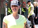Happy and healthy Amber Rose shows off her post baby body in a T-shirt and leggings as she tucks into organic lunch