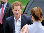 Admirer: Harry chats with a female fan as he arrives at the polo club, ahead of his taking part in a charity match