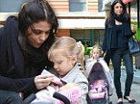 Young at heart! Bethenny Frankel plays dolls with daughter Bryn as pair enjoy a springtime outing