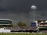 Overcast: Bruce Martin bowls to Joe Root at Lord's