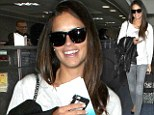 The clothes don't make this woman! Adriana Lima covers up but still manages to stun as she flies out of Los Angeles