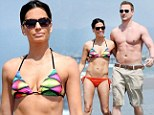 She's still got it! Dancing With The Stars champ Melissa Rycroft reveals her flawless figure in bikini as she frolics on the beach with husband Tye Strickland
