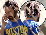 Pretty in pink... curlers! Bradley Cooper temporarily bids farewell to his masculinity as he sports feminine rollers in his hair