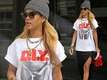 Newly-single Rihanna pushes the boundaries of taste as she steps out in self pleasure T-shirt