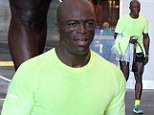 Waxing poetic! Seal shows offs his smooth-shaven legs after sweating it out at the gym