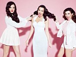 Kat fight: Khloe and Kourtney Kardashian pretend to pull Kim's hair as they pose for a jokey new shot as part of their latest Dorothy Perkins campaign