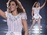 What baby? Beyonce is back to her best at rescheduled concert as she seems to dispel pregnancy rumours in tight costume