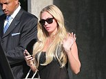 She takes her personal safety seriously! Petra Ecclestone enjoys shopping trip with armed bodyguard