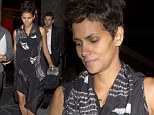 Halle Berry conceals her growing curves in an unusual draped dress... as she labels her pregnancy a 'miracle'