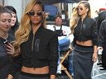 Definitely not a fat day! Rihanna makes an asset of her toned stomach in cropped bomber jacket and pencil skirt