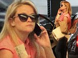 She's a busy bee: Reese Witherspoon takes a phone call on way to lunch meeting as it is revealed she will reunite with Joaquin Phoenix in new project