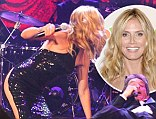 Taking a tumble! Heidi Klum exposes half her bottom as she appears to fall onstage at charity gala