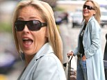 High on life! A giddy Sharon Stone, 55, shows off her laugh lines as she flashes a smile at the Los Angeles airport