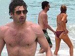 McCheeky! Patrick Dempsey gives his wife Jillian Fink an affectionate slap on the bottom as the couple enjoy a dip in sea
