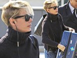 No knight in shinning armor? Michelle Williams is forced to do some heavy lifting at the airport struggling with giant heavy suitcase