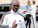 They must adore each other... and coffee: Eddie Murphy mugs for cameras with model girlfriend Paige Butcher on their daily java run