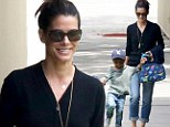 Sanda Bullock smiles as son Louis runs home from school