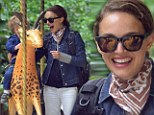 Settling in nicely: Natalie Portman treats son Aleph to a carousel ride in Paris as they prepare to make the city their home