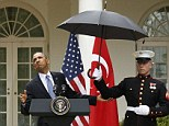 Hoping for a break in the storm: Obama faced a barrage of questions over three simultaneous scandals engulfing his administration today during a press conference in a rain-soaked Rose Garden with the Turkish Prime Minister