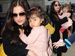 Slender Aishwarya Rai makes her return to Cannes one year after cruel weight jibes... and this time her daughter comes too