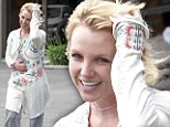 Britney Spears emerges from recording studio looking happy and tired after her track Ooh La La leaked online