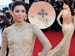 Golden girl Eva Longoria brings sexy back in a peekaboo gown... and shows off her Celtic cross tattoo at Cannes premiere of Le Passe