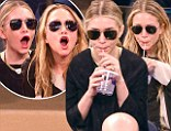 They could be twins...oh wait, they are! Mary Kate and Ashley Olsen are comically in sync at star-studded basketball game