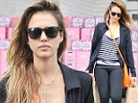 She's no diva! Jessica Alba shows off her curves in skintight trousers as she lugs her own grocery bags