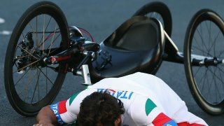 Photo: Alessandro Zanardi of Italy celebrates winning the men's Individual H4 Road Race on Day 9 of the London 2012 Paralympic Games at Brands Hatch.